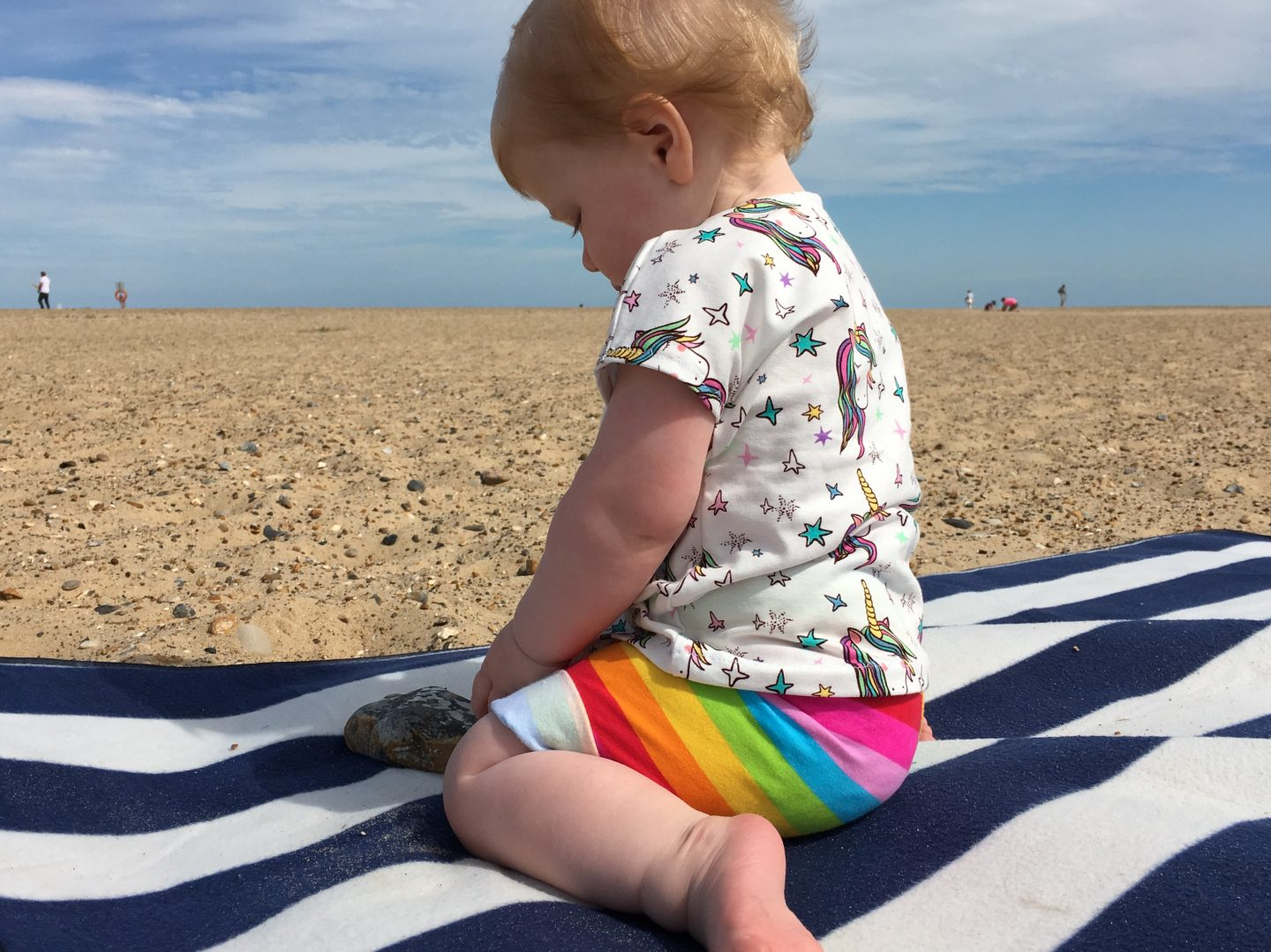 Polly Pony unicorn tee and rainbow shorts