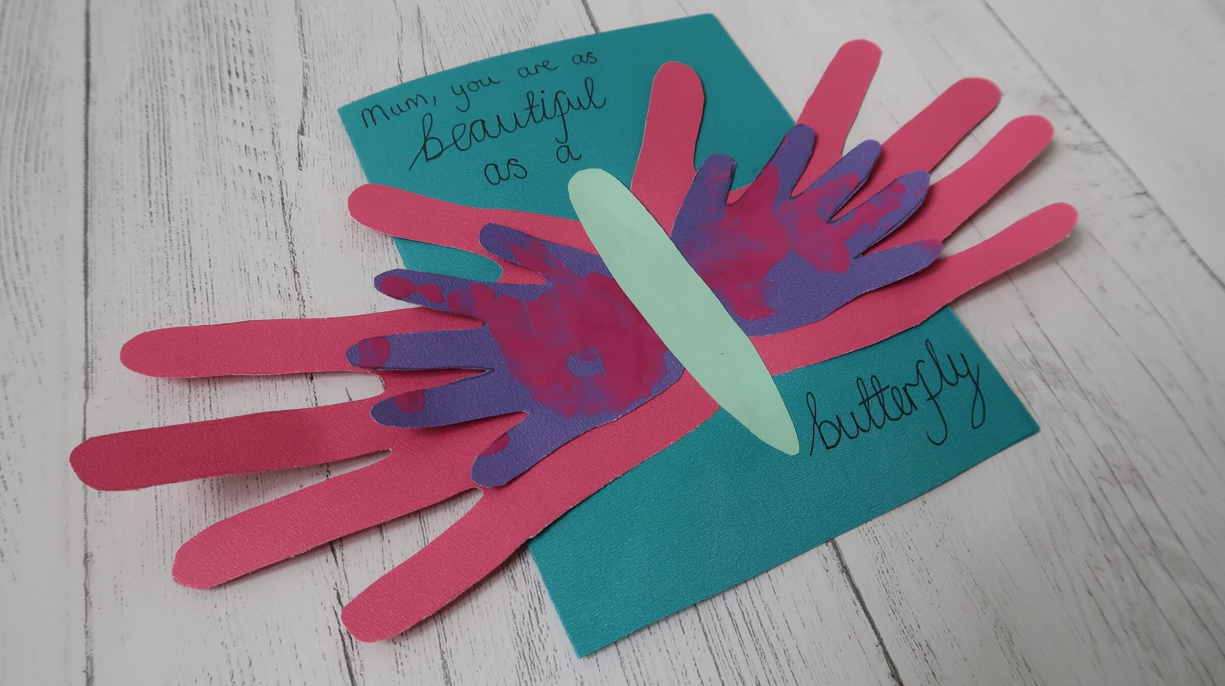 Diy handprint mother 39 s day craft pondering playtime for Butterfly hands craft