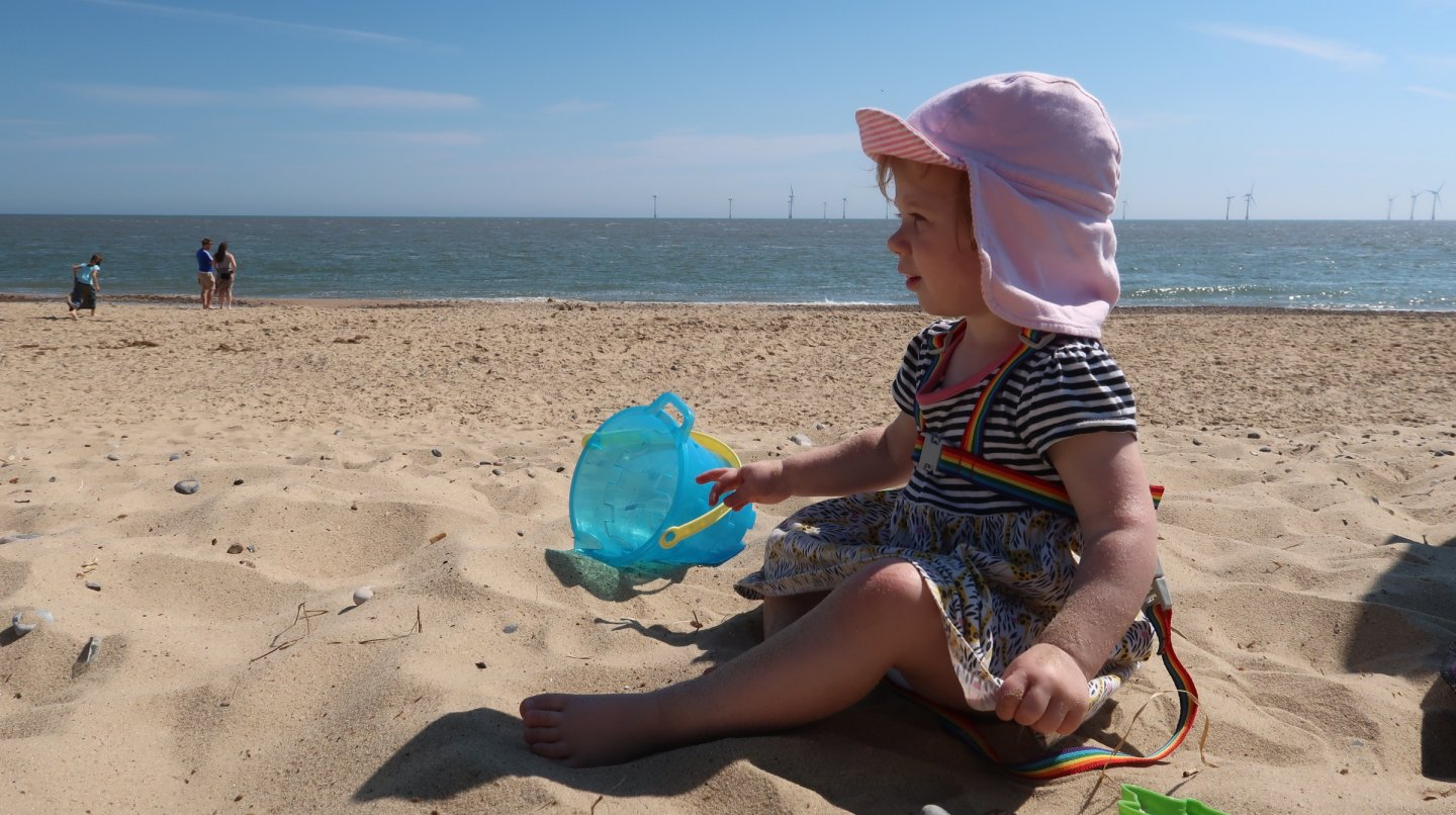 M at the beach with her bucket and spade