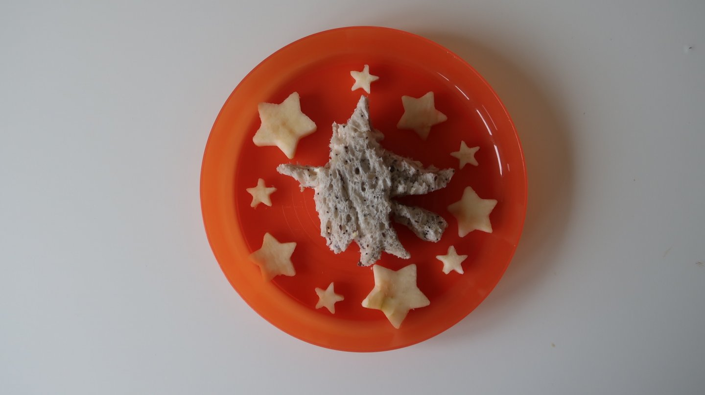 Room on the broom witch-shaped cheddar sandwich with apple stars.