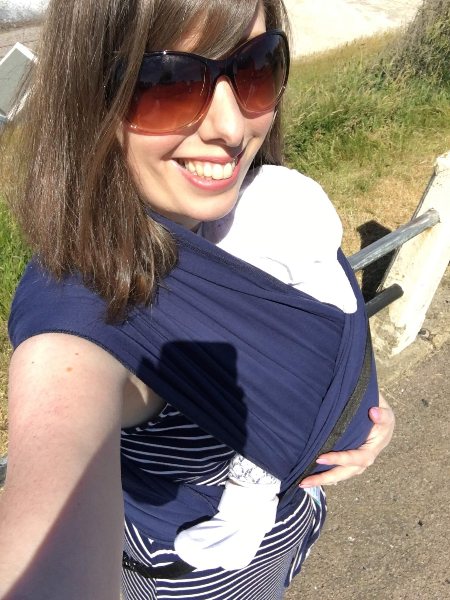 Babywearing baby in Pavlik harness in a hip safe sling
