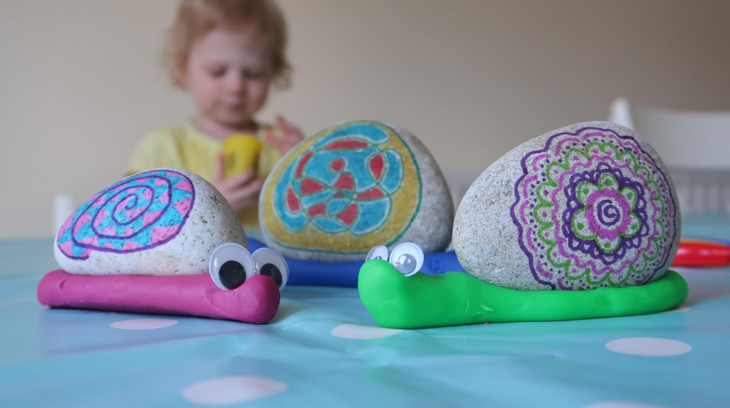 Easy EYFS rock painting activity linked to The Snail and the Whale by Julia Donaldson