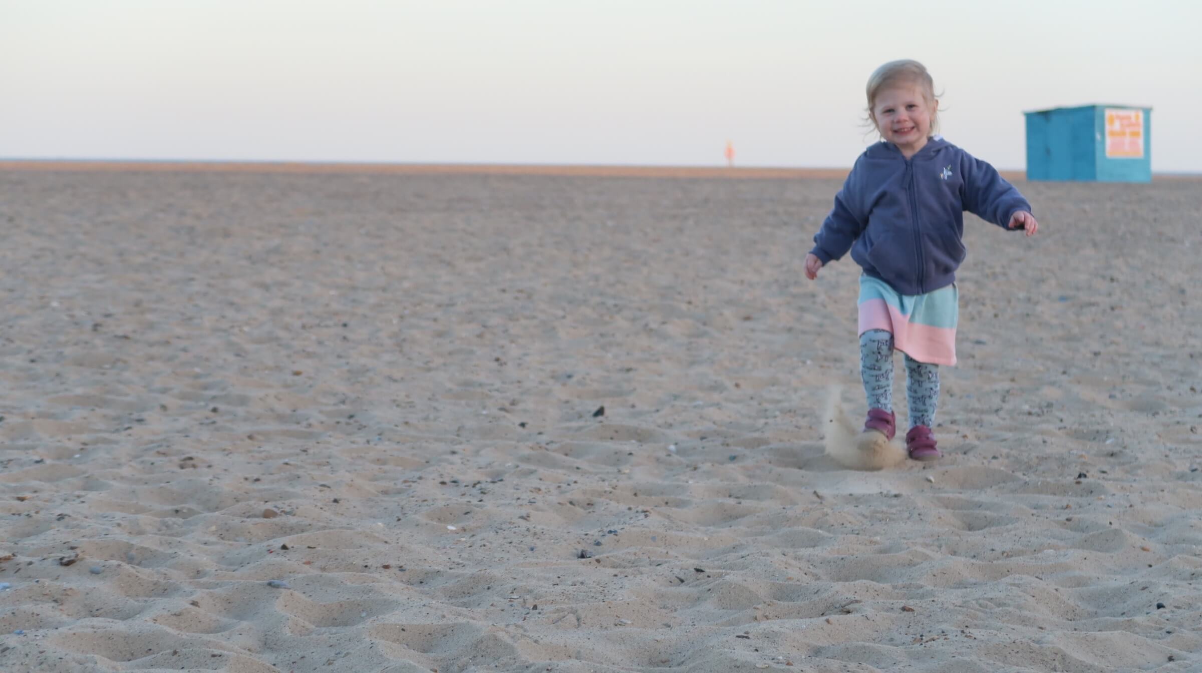 M running across the beach at Great Yarmouth