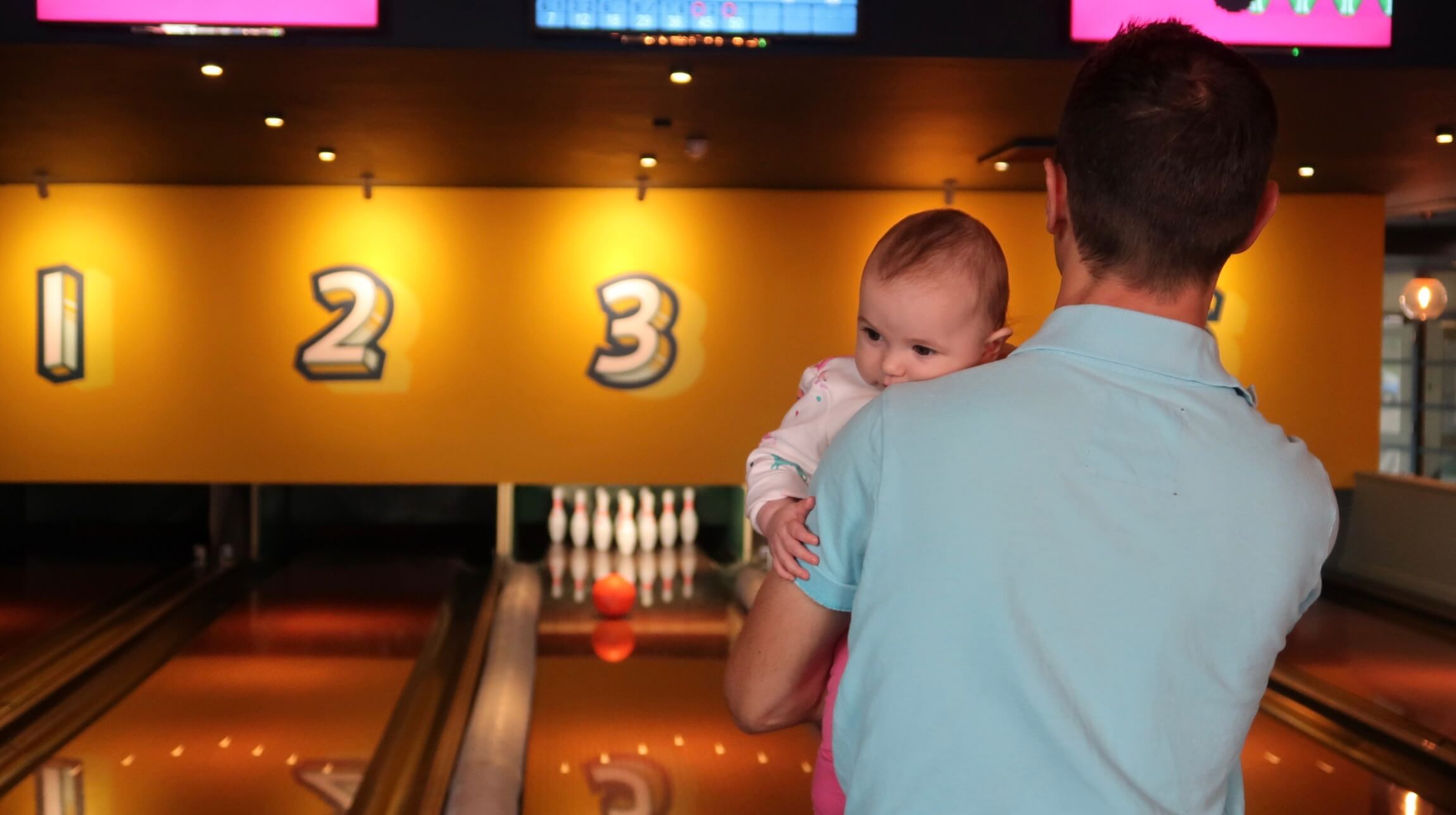 B on her daddy's shoulder at bowling
