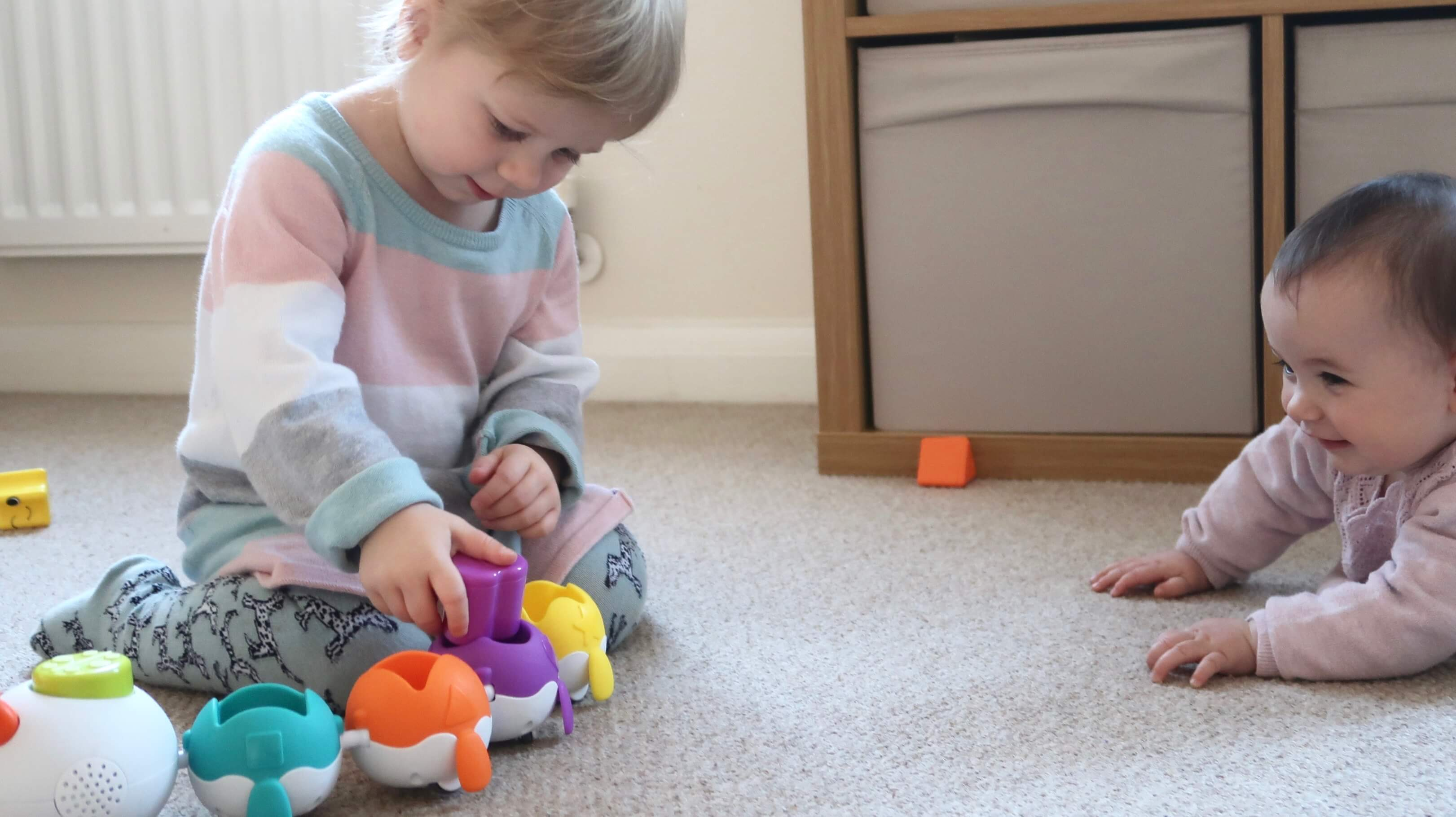 Little Tikes Fantastic Firsts Singing Sorter Review - M plays with the sorter as B watches