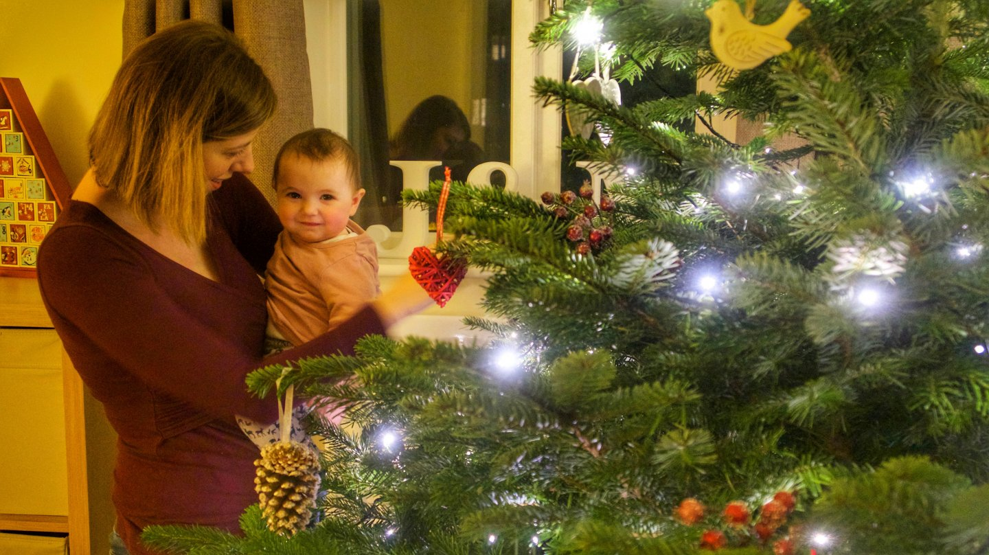 B decorating the tree with mummy